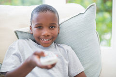 Little boy watching tv on the couch Stock Photos