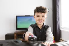 Little boy watching TV lying in the living-room. A little boy watching TV lying in the living-room Stock Photos