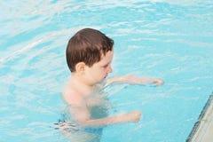 Little boy in water Stock Photo