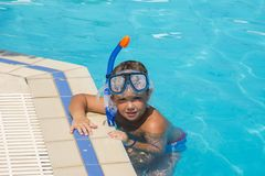 The little boy in the water with diving equipment Stock Image