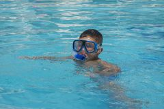 The little boy in the water with diving equipment Stock Photo