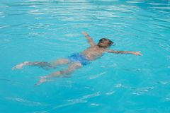 The little boy in the water with diving equipment Stock Images