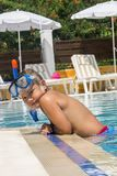 The little boy in the water with diving equipment Royalty Free Stock Photos