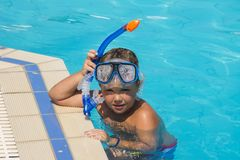 The little boy in the water with diving equipment Royalty Free Stock Images
