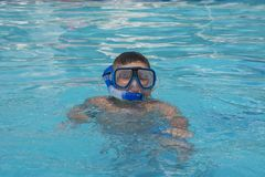 The little boy in the water with diving equipment Stock Photography
