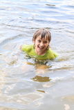 Little boy in water. Little boy - kid in wet t-shirt in the water Stock Images