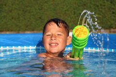 Little boy in the pool royalty free stock photography