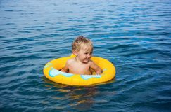Little boy in water on rubber ring Stock Photo