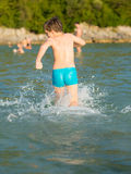 LIttle boy in water Stock Image