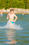 LIttle boy in water Royalty Free Stock Image