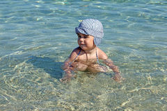 Little boy in water Stock Photos