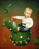 Little boy with  watering can Stock Photos