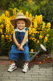 Little boy watering flowers Stock Images