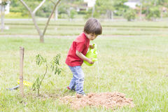 Little boy watering plants Outdoors Royalty Free Stock Photo