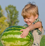 Little boy with watermelon. Little boy watermelon in his hands Royalty Free Stock Photos