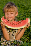 Little boy with watermelon. Little boy with a piece of watermelon in hands Royalty Free Stock Image