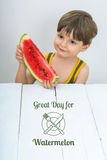 Little boy with watermelon. Little boy is having a slice of watermelon and sample text Royalty Free Stock Image