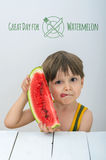 Little boy with watermelon. Little boy is having a slice of watermelon and sample text Stock Photos