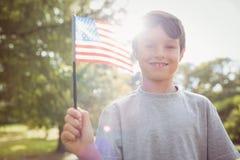 Little boy waving american flag Royalty Free Stock Photos