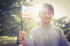 Little boy waving american flag Stock Images
