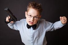 A little boy with a weapon Stock Image