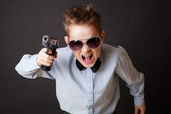 A little boy with a weapon Stock Photo
