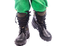 Little boy  wearing big shoe Stock Image