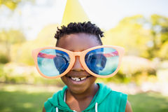 Little boy wearing big toy glasses Stock Photos
