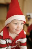 Little boy wearing Christmas Hat Stock Photography