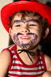 Little boy wearing a cowboy hat. Beard is painting on the face Royalty Free Stock Image