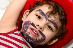 Little boy wearing a cowboy hat. Beard is painting on the face Royalty Free Stock Photography