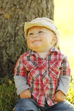 Little boy wearing a cowboy hat playing on nature Stock Photography