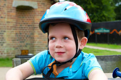 Little boy wearing a cycling helmet Royalty Free Stock Photo