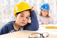 Little boy wearing a engineering helmet Stock Images