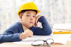 Little boy wearing a engineering helmet Royalty Free Stock Photo