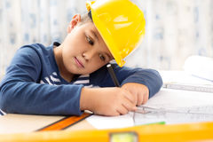 Little boy wearing a engineering helmet Royalty Free Stock Photography
