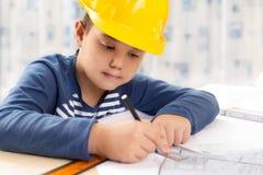 Little boy wearing a engineering helmet Royalty Free Stock Image