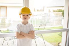 Little boy wearing a engineering helmet Royalty Free Stock Photos