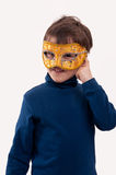 Little boy wearing a gold carnival mask, pretending to be a superhero Royalty Free Stock Photography