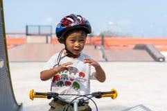 Little boy wearing helmets ridding bike . Royalty Free Stock Image