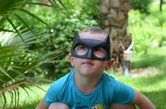 Little boy wearing a mask Batman. R, looking up Stock Images