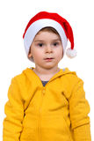 Little boy wearing on red Santa helper hat. Isolated over white background. Stock Image