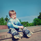 Little boy wearing roller skates Royalty Free Stock Photography
