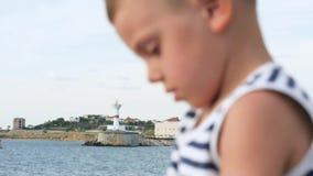 Little boy wearing sailor stripes shirt stock video