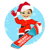 Little boy wearing santa claus costume snowboarding. Over winter background Stock Photos