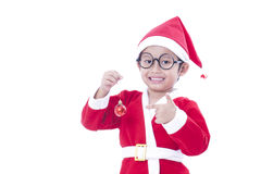 Little boy wearing Santa Claus uniform. Stock Images