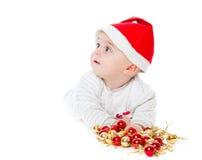 Little boy wearing a Santa hat Stock Photos