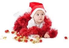 Little boy wearing a Santa hat Stock Image