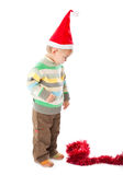 Little boy wearing a Santa hat Stock Images
