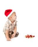Little boy wearing a Santa hat Stock Photo